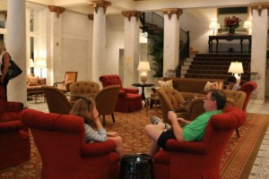 Guests recline in the newly re-outfitted, more casual lobby of the Capital Hotel.